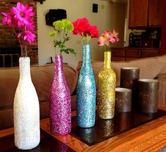 Cover the wine bottle with glitter sheets, colorful thread, paint, glass beads, or anything you can think of and make use of them like a flower vase.