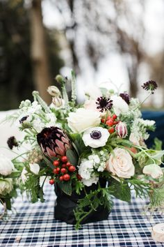Wintery + festive floral centerpiece: Festive Christmas table decor: http://www.stylemepretty.com/living/2015/12/07/a-woodland-winter-dinner-party/ | Photography: Sarah Hill - http://www.sarahhillphotography.com/