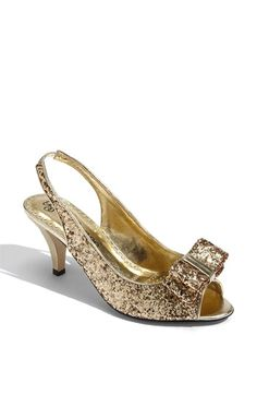 "These look a lot like Kate Spade's ""Charm"" shoe for a hell of a lot less.  $80.00  Also in silver."