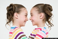 Mirror Image Twins. About 25 percent of identical twins develop directly facing each other, meaning they become exact reflections of one another -- they may be right and left handed, have the same birthmarks on opposite sides of their bodies or have the same hair whorls that swirl in opposite directions. This occurs when the twins split from one fertilized egg more than a week after conception.