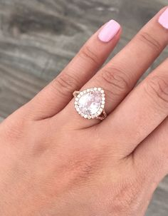 Handmade 14K rose gold split shank diamond engagement ring featuring a GIA certified natural/unheated and very rare pear cut peach pink sapphire measuring 10.5 x 8.5 mm and weighing 3.63 ct. (VS)  Center stone is flanked and surrounded by round brilliant cut diamonds with a total carat weight of 0.54 cts.(G,VS2/SI1)  Size 6, can be sized up to 8. GIA certificate included with purchase.  *Original Studio 1040 design.  *Ready to ship.  SKU 100608-1