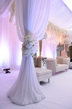 """Krishna and Heren's romantic """"Snow White"""" wedding reception with cascading orchids, white roses and hydrangeas and metallic accents   See the full wedding: http://www.xaazablog.com/snow-white-elegant-indian-wedding/"""