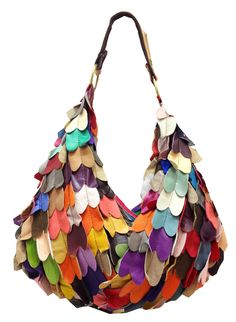 Stunning! this unique multi coloured leather cut-outs handbag is something that doesn't come along every day. Hand crafted from genuine leather the multicoloured elongated heart shaped  stands out amongst the the masses of plain old ordinary handbags. Read more....http://ilovetunics.mybisi.com/product/multi-colour-leather-hand-bags