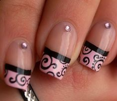 pink nail tip with curlicues