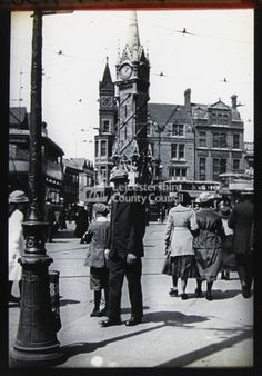 Early 1900s crowd near clock tower: Lantern Slide, Leicestershire Record Office
