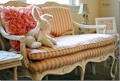 Bunny on a pink stripe settee. So sweet for a girl's room.