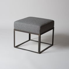 Perfect for adding casual seating to any room in your home. Featuring our exclusive, soft and luxurious, Tori Murphy 100% merino lambswool cushion on a modern geometric blackened steel base. // #interiordesign #burkelman