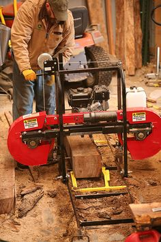 Hud-Son HFE21 Bandsaw sawmill in action at Hank Will's farm. - GRIT Magazine