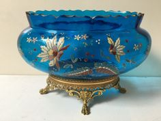 Catawiki online auction house: Old blue glass bowl on copper base with floral motif in relief