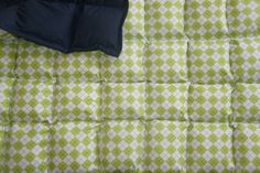 Argyle and navy all cotton weighted blanket.  Stuffed with polypellets for weight and polyfill for fluffiness.  www.etsy.com/shop/threehighchairs