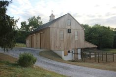 Bank barns can be adapted for use as a horse barn, event venue, or personal hobby space. Barn Garage, Garage Art, Garage Plans, Garage Ideas, Horse Barns, Old Barns, Barn Apartment Plans, King Construction, Barn Builders