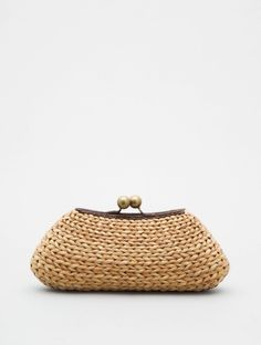 Gorgeous.  Wonder how they did the gauge increase from one end of a row to the other?!    Raffia Clutch with Ball Clasp  by Kayu