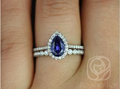 Ohhhh my gawd. This is gorgeous! It's a little pricy but comes with the wedding band also. Tabitha & Christie White Gold Pear Blue Sapphire and Diamonds Halo Wedding Set (Other metals and stone options available) Blue Sapphire Rings, Sapphire Diamond, Halo Diamond, Diamond Rings, Halo Rings, Sapphire Pendant, Sapphire Earrings, White Sapphire, Boho Earrings