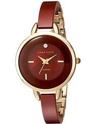 Anne Klein Women's AK/2132BYGB Diamond-Accented Gold-Tone and Burgundy Ceramic Bangle Watch by Anne Klein $110.00Prime FREE Shipping on eli
