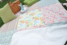 patchwork picnic quilt...made waterproof on one side with a vinyl tablecloth