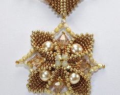 Swarovski crystals and pearls nestled in a peyote seed bead base creating a 3-dimensional star - Constellation Pendant