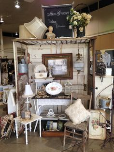 Love this display made from old doors and a bed spring. Perfect for hanging items from above.