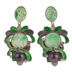 Rare Vega Maddox earrings, composed of sterling silver with enamel, amethyst and  jadeite.   2-3/4 x 1-1/2 inches.  The jadeite and amethyst stones are bezel-set and surrounded the enamel.  The earrings have silver posts. Each earring weights 14.3 grams<br /><br />Vega Maddox was a Southern California jewelry designer in the 1960s and 1970s.  Her whimsical jewelry is multi-dimensional and very sought after.<br /><br />Vega's  jewelry is most often large, sometimes massive.  These earrings…