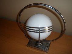 Spherical Art Deco table lamp. DenGarden.com breaks down the design, motifs, and color schemes of the art deco movement.