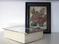 How to Make a Vintage Painting into a Cabinet.  Step-by-step instructions for crafting a piece of art into a useful storage space.