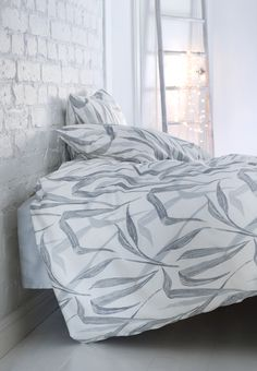 Kaisla Duvet Cover Set | Pentik | Kaisla bed sheets are made of pleasant cotton satin. The Kaisla pattern is designed by Lasse Kovanen. Kaisla bed linen are suitable for every home, and everyone will find their favourite colours from the selection. What would be a more refreshing theme for bed linen than reeds swaying in the sea wind?