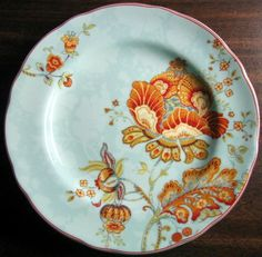 Decorative Dishes - (http://www.decorativedishes.net/aqua-blue-urban-chic-exotic-flower-orange-red-plate/)