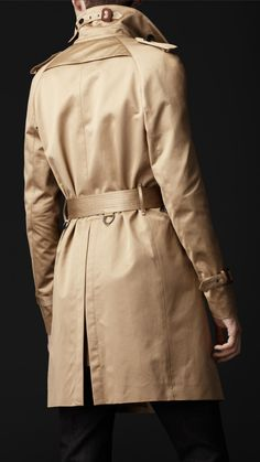 e34ed157b5c4 Rich buffalo-horn buttons are a traditional detail on this signature  Burberry London trench. The timeless design is updated in a modern
