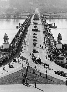 11/25/63: The funeral procession moves over the Potomac River towards Arlington Cemetery.