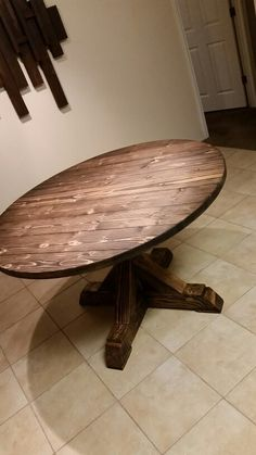 round farmhouse table or something similar and rustic for breakfast nook