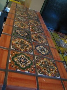 We love these hand painted Mexican tiles.  Each one is just so beautiful and a piece of art.  The designs are actually standardized and have been around for hundreds of years--passed down in families.