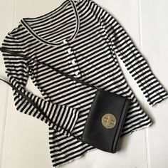 Kate Spade Saturday Top!PM Editor shared Kate Spade Saturday stripes Top! Let Loose in the black and white striped top! Cute buttons up the front! Model and linen blend! Great condition! Please not tiny flaw in the last picture from the store tag a tiny hole at the collar and not noticeable! kate spade Tops Tees - Long Sleeve