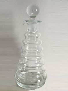 Clear glass decanter by Thomas Webb. Very modern but probably late 19 C made up of rounded band upon band. A very fun piece crying out for a drink though Crystal Decanter, Clear Glass, Crying, Display, Band, Crystals, Modern, Floor Space, Sash