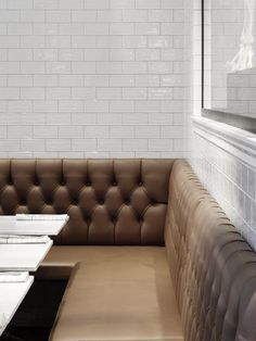 Love this design for residential kitchen dining. leather banquet, carrara marble and white subway tile. Restaurant Museet in Stockholm I Remodelista