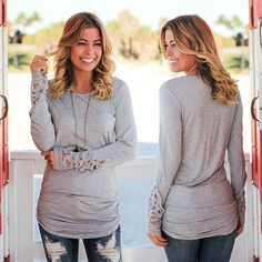 HERE IN GRAY! Our ruched top with crochet sleeves looks amazing in this new color! Shop at savedbythedress.com