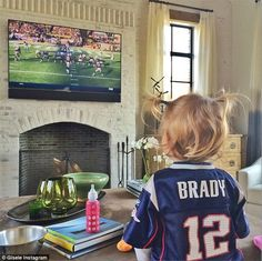 Daddy's girl: Gisele Bundchen shared a snap of her daughter Vivian wearing her father Tom Brady's American football jersey as they watched him play on Sunday