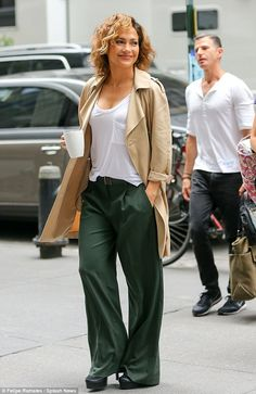 Caffeine fix: Jennifer Lopez couldn't part with her trusty mug as she arrived on to the Manhattan set of Shades Of Blue on Wednesday morning 15 Jul 2015