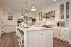 *Like silver pendants *Like bright white with glass upper cabinets *Like shaker-style but with a bit more detail cabinetry *white cabinetry *Marble counters