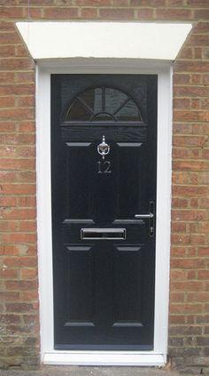 Buy 4 Panel Sunburst Composite Front Door in Black Online Double Door Design, Sliding Door Design, Front Door Design, Kitchen Patio Doors, Faux Wood Garage Door, Front Door Canopy, Exterior Door Colors, Composite Front Door, Sliding Door Window Treatments