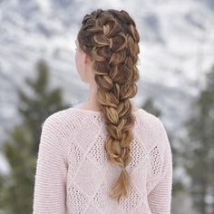 This one is rather easy than how it looks. All you have to do is make two dutch braids and combine them together at the end. Then just loosen the loops to make it look bigger. You may want to make the loops the same sizes so it would look organized instead of messy.