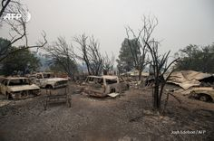 UNITED STATES, Middletown : Burned vehicles sit at a property charred by the Valley fire in Middletown, California on September 13, 2015. The governor of California declared a state of emergency Sunday as raging wildfires spread in the northern part of the drought-ridden US state, forcing thousands to flee the flames. The town of Middletown, population 1,300, was particularly devastated by the Valley Fire, according to local daily Santa Rosa Press-Democrat, which said the fire grew fr... U.s. States, United States, Governor Of California, California Wildfires, Outdoor Furniture Sets, Outdoor Decor, September, Sunday, Weather
