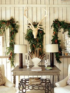 For Christmas- natural garlands over everything! Feathers bring an earthy naturalism of the season indoors.