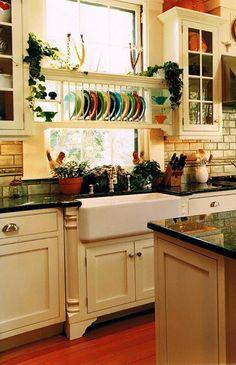 dish rack, apron sink, window.