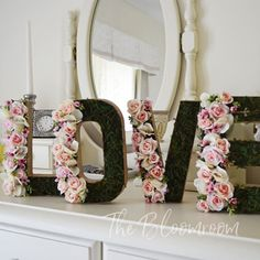 8 Pink Mini Rose & Moss Flower Letter Set LOVE - Our gorgeous moss and pink mini rose bud flower letter set is made of paper mache and filled with beautiful the pink rose blooms and surrounded by wax flower and hydrangea with a scattering of eucalyptus seeds. • Letters measure 12.5