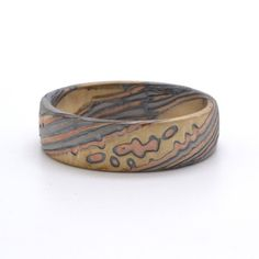 Rustic Twist Pattern Mokume Gane Ring In Palladium, 14kt Red Gold, 14kt Yellow Gold Palladium and Oxidized Silver with matte finish