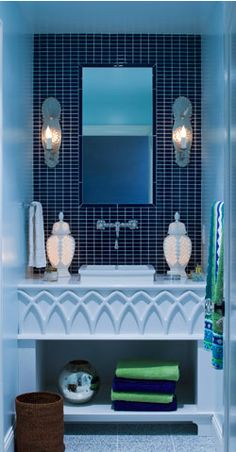 Shapes, textures and different shades of blue for a powder room