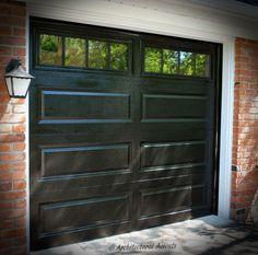 Single Black Garage Door. White aluminum capping on the frame. Stockton Glass.