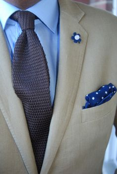 Tan jacket, blue patterned shirt, grey knit tie (could also go with navy or brown knit tie)