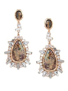 If the Flinstones were headed to a festive soiree, we imagine Wilma might reach for something like this: rough edges and asymmetrical styling belie the rich mixed media materials of these dramatic drops.  This is part of the ELLE Holiday Shop