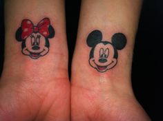 Mickey and Minnie wrist tattoo.