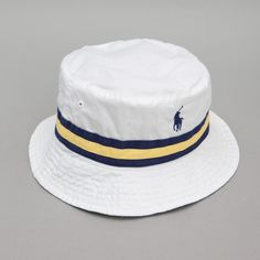 The Reversible Bucket Hat from Mr Ralph Lauren is two hats in one — one side is a nice chequered affair, great for a casual day by the riverside, and the other is a bold white number, which, as it happens, is also great for a casual day by the riverside.